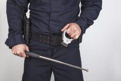 Policeman gun Stock Photo