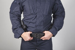 Policeman with gun Stock Photo