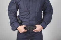 Policeman with gun. Policeman holding his zone with gun Stock Photo