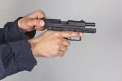 Policeman with gun. Run out of bullets Royalty Free Stock Photography