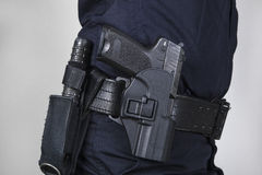 Policeman with gun Stock Image