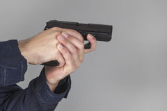 Policeman with gun. Policeman shooting with his gun Stock Photography