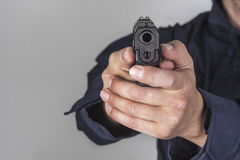 Policeman with gun. Policeman shooting with his gun Stock Image