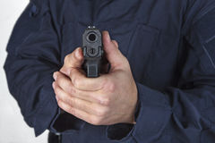 Policeman with gun. Policeman shooting with his gu Royalty Free Stock Photo