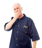 Policeman with hand over her mouth Royalty Free Stock Photography