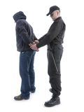 Arresting. Policeman handcuffing hooded man, shot on white Stock Image