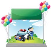 A policeman with his car near the green empty board Royalty Free Stock Photo