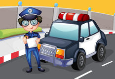A policeman with his police car Royalty Free Stock Image