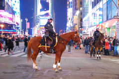 Policeman on horse in Times Square, New York City. Manhattan royalty free stock image