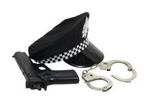 Policeman kit. Including a black Police hat with badge and a shiny brim, and a gun with a set of handcuffs - path included royalty free stock image