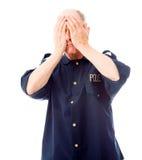 Policeman looking depressed Stock Images
