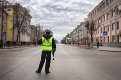Policeman looks at the empty street. Tyumen, Russian Federation, 01/05/2014 Royalty Free Stock Photos