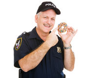 Policeman Loves Donuts stock photos