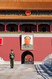 Policeman and Mao's portrait Stock Photo