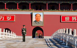 Policeman and Mao's portrait Royalty Free Stock Photography