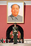 Policeman and Mao's portrait Stock Image