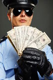 Policeman with with money Royalty Free Stock Photos