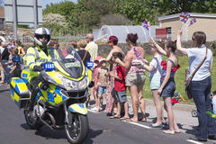 Policeman on motorbike. Olympic torch relay Stock Photography