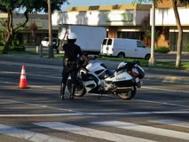 Policeman and motorcycle. Police motorcycle blocks a road that is closed Stock Photos