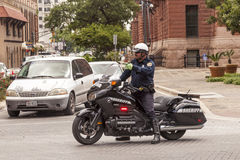 Policeman on motorcycle Stock Photography