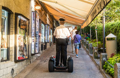 Policeman moved down the street to the segway. San Marino Royalty Free Stock Photography