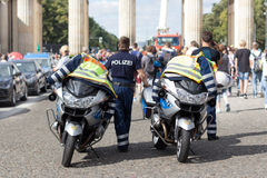 Policeman officer standing next to police motorbikes Stock Image