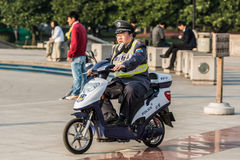 Policeman patrolling on people's square shanghai china Royalty Free Stock Images