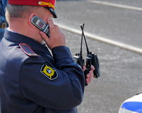 Policeman on the phone Royalty Free Stock Photos