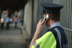 Policeman on the phone Royalty Free Stock Photography