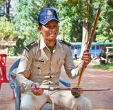 Policeman playing instrument Thro khmer, Cambodia. Stock Photography
