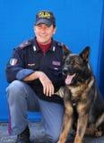 Policeman and police dog Royalty Free Stock Photo