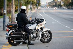 Policeman on a police motorbike Stock Images