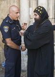 Policeman and priest Royalty Free Stock Photography