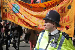 Policeman and protesters Royalty Free Stock Photography
