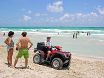 Policeman in quad-biking, the beaches of Miami patrol. Royalty Free Stock Images