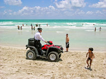 Policeman in quad-biking, the beaches of Miami patrol. Royalty Free Stock Photography