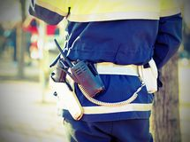 policeman with a radio transmitter and gun Royalty Free Stock Images