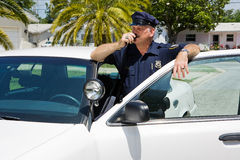 Policeman Radioing Headquarters Royalty Free Stock Photos