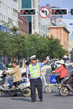Policeman regulates local traffic, Kunming, China Royalty Free Stock Images