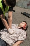 Policeman resuscitating victim Royalty Free Stock Images
