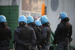 Policeman with riot gear  and helmets during the uprising town Stock Image