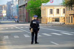 Policeman on a road Royalty Free Stock Photo