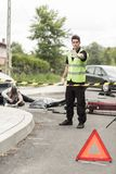 Policeman at road accident scene. Vertical view of policeman at road accident scene Stock Images