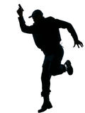 Policeman running with a handgun Royalty Free Stock Photography