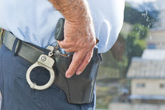 Policeman's Hand with a Gun Royalty Free Stock Photo