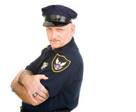 Policeman Serious and. Handsome policeman leaning back on invisible white space, with a expression. Isolated design element stock photo