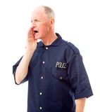 Policeman shouting Stock Photo