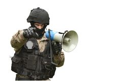 A policeman shouts orders into a megaphone Stock Image