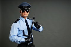 Policeman shows with nightstick Royalty Free Stock Photos