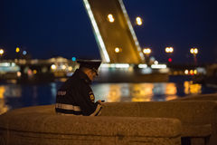 Policeman with a smartphone Royalty Free Stock Images